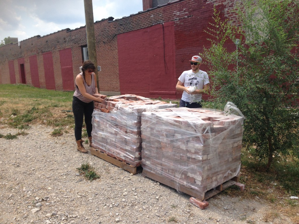 Inspecting the bricks obtained from Century Used Brick.