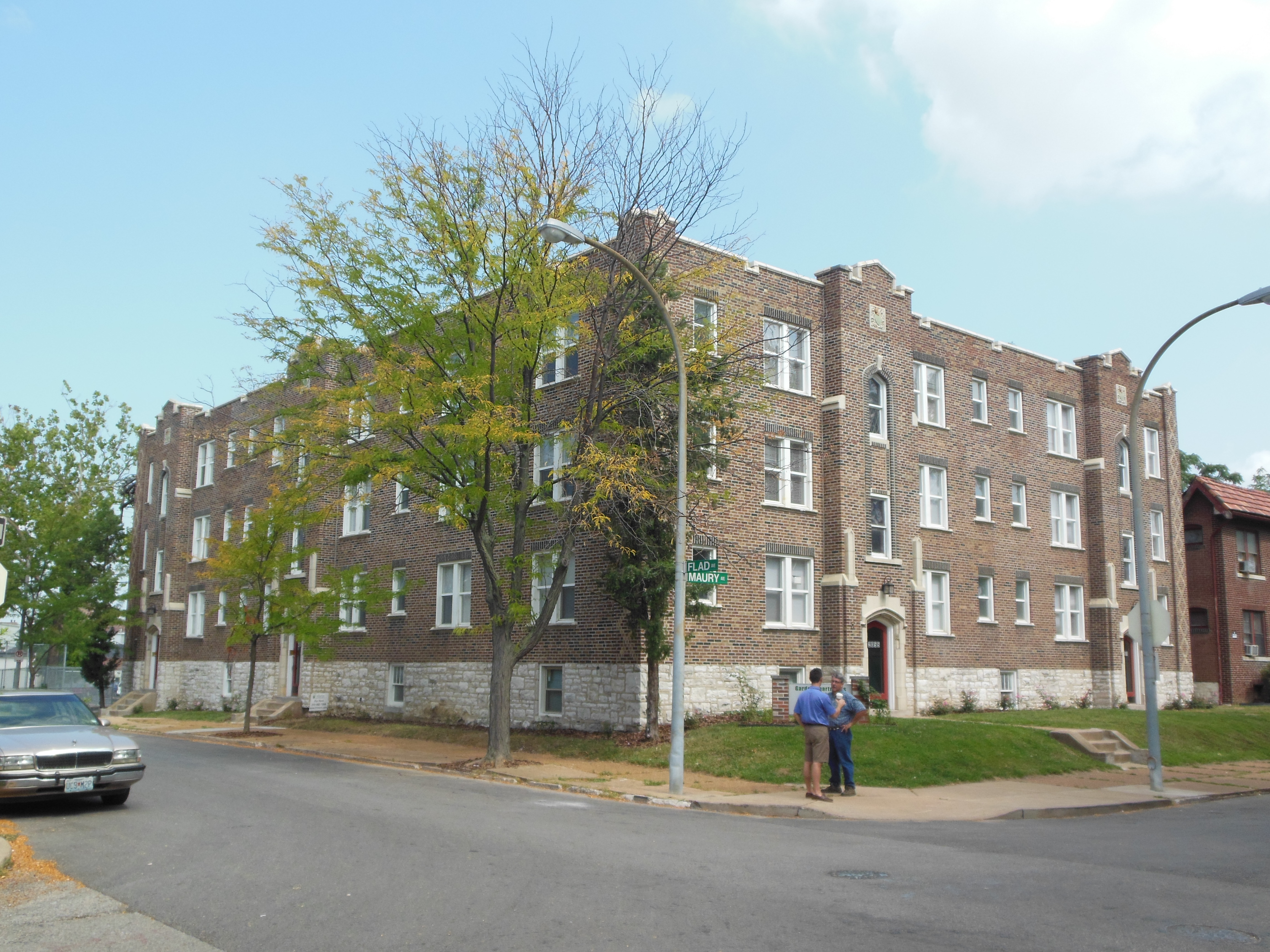 brick apartment building. The building is a corner anchor  Apartments at 2051 55 Maury Avenue Preservation Research Office